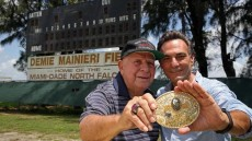 Coach Demie Mainieri and team captain Steve Polisar pose at North Campus field highlighting the 1964 college national champions  (Photo Credit: Miami Herald Staff)