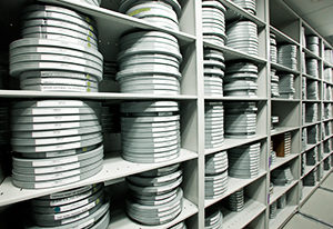 Shelves filled with film canisters at MDC's Wolfson Archives