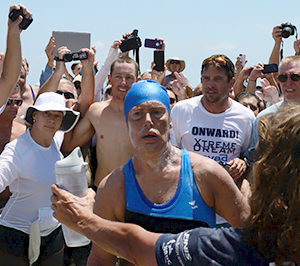 Diana Nyad steps onto Smathers Beach in Key West