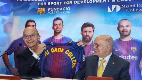 MDC President Eduardo J. Padrón and FC Barcelona First Vice President Jordi Cardoner at a press conference display a sports jersey with the MDC name on it.