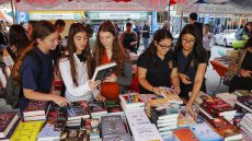 Girls browsing through books at Book Fair