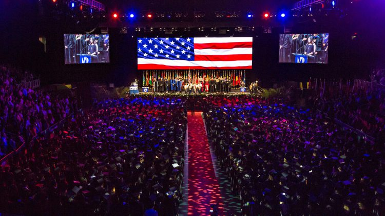 Thousands of students attending commencement in auditorium
