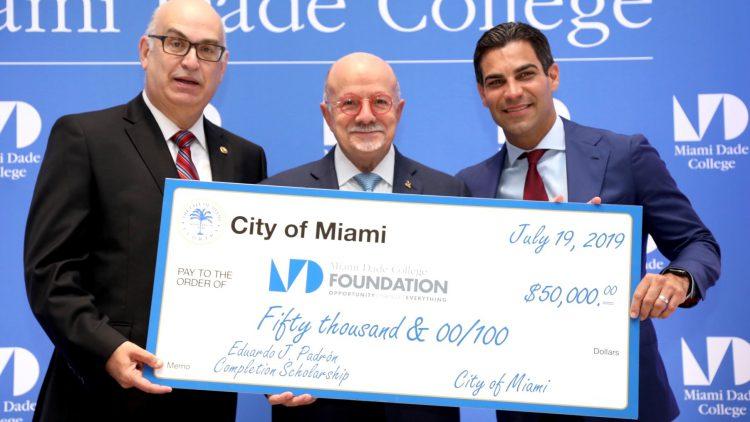 Check presentation to Dr. Eduardo J. Padrón with City Manager Dr. Emilio T. Gonzalez and City of Miami Mayor Francis Suarez