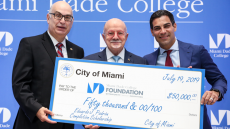 Check presentation to Dr. Eduardo J. Padrón with City Manager Dr. Emilio T. Gonzalez and City of Miami Mayor Francis Suarez