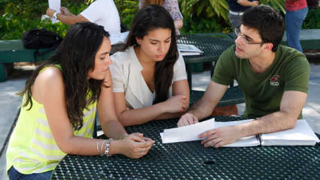 Students sitting together outdoor at campus patio