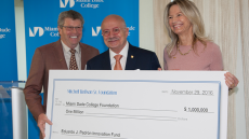 Dr. Eduardo J. Padrón receiving check from The Mitchell Wolfson Sr. Foundation