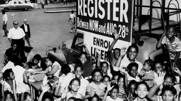 Archival photo registration mobile with black children around it