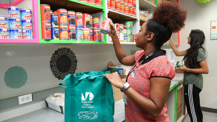 MDC student and staff at food pantry