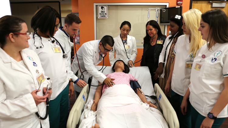 MDC nursing students practicing medical procedure