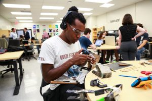Student using tools at Makers Lab