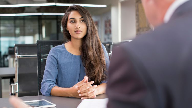 female student speaking with advisor
