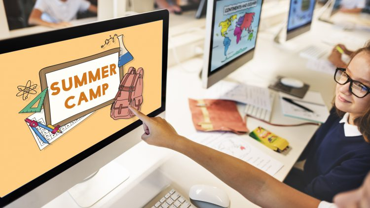 kid's hand pointing at computer screen saying Summer Camp