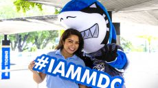 Finn with MDC student holding the hashtag sign #IAMMDC