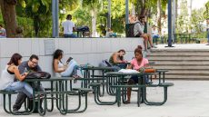 Students at tables on campus