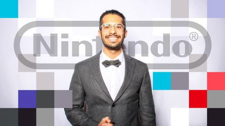 Portrait of Michael Chatila in front of Nintendo logo and graphics