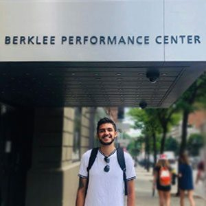 Mateo Suarez standing by Berklee Performance Center entrance