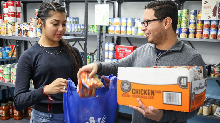 Student receiving food at MDC Food Pantry