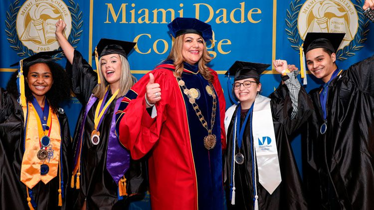 Madeline Pumariega with alumni at commencement 2021