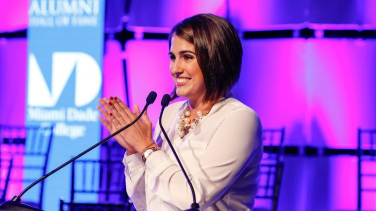 Alex de Armas smiling by podium at MDC Hall of Fame