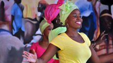 Haitian woman in traditional dress dancing