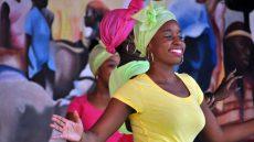 Haitian woman in traditional dress dancing