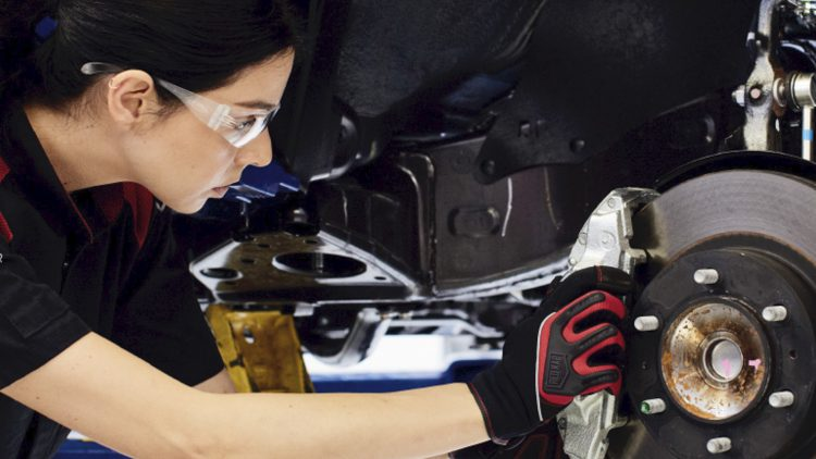 Young woman working on auto repair