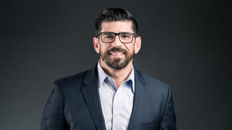 Headshot of business executive Tony Rivas