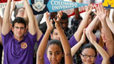 diverse honors college students clapping their hands in the air