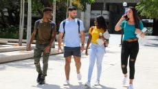 Diverse group of students walking outdoors at Kendall Campus